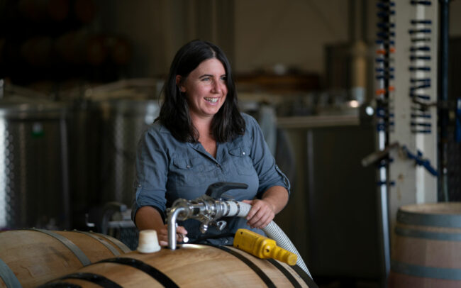 Filling barrels in the winery at Brittan Vineyards