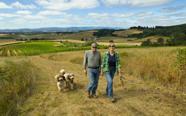 Couple walking in fields at Brittan Vineyards